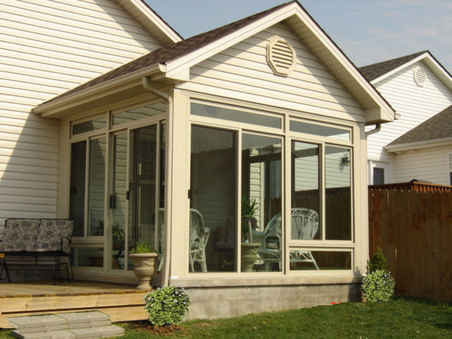 Wood Finished Gable Ceiling. Beautiful Sunroom And Deck Addition With  Sliding Glass Doors ...