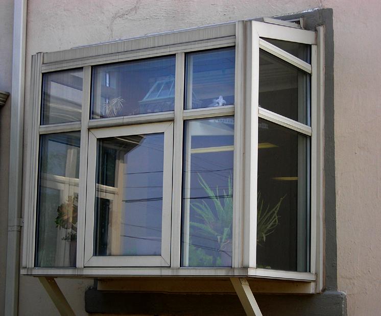 Decorating garden box window inspiring photos gallery for Exterior kitchen door with window